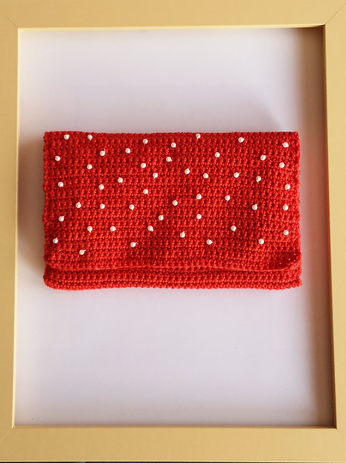 red crocheted soft purse with white beads