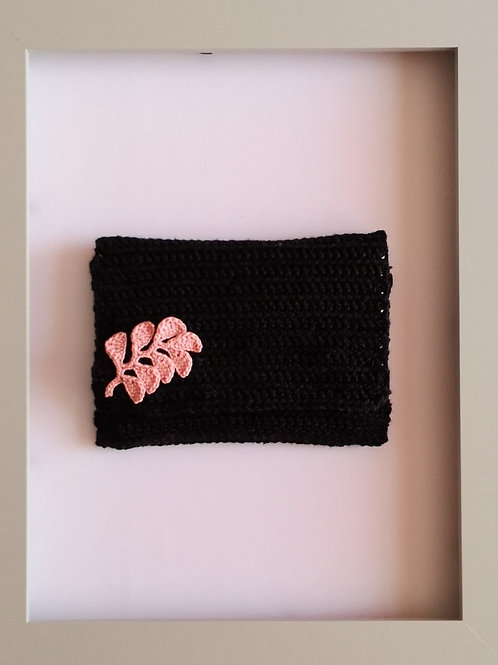 soft crocheted black purse with pink leaves