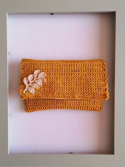 soft crocheted mustard yellow purse with light leaves