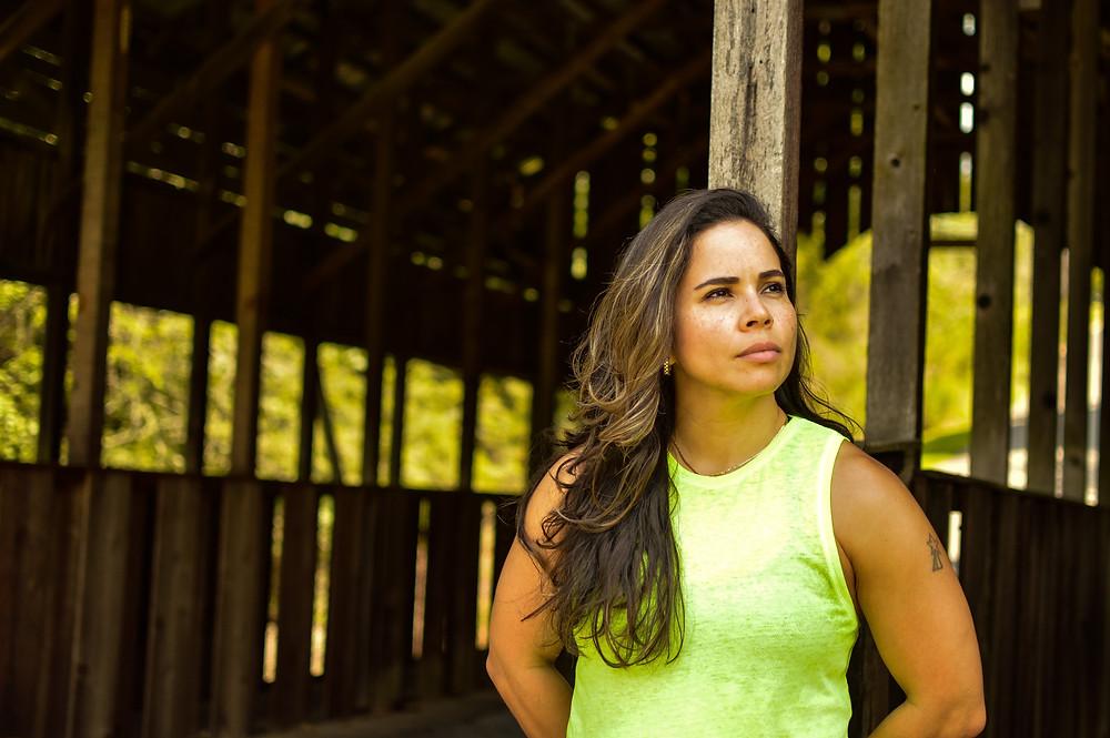 Athletic woman standing near a bridge