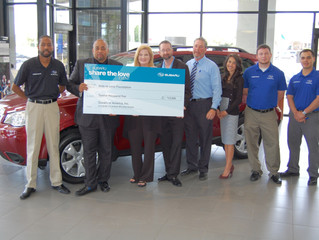 "Landers McLarty Subaru ""Shares the Love"" with Kids to Love"