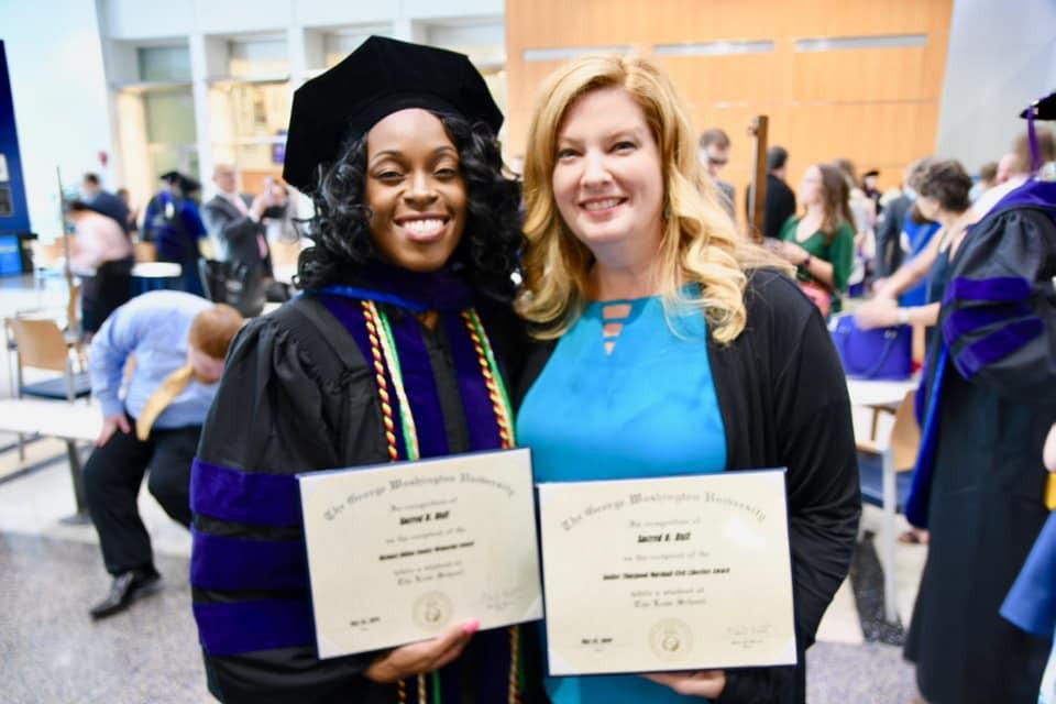 Sacred Huff with Lee Marshall holding diplomas