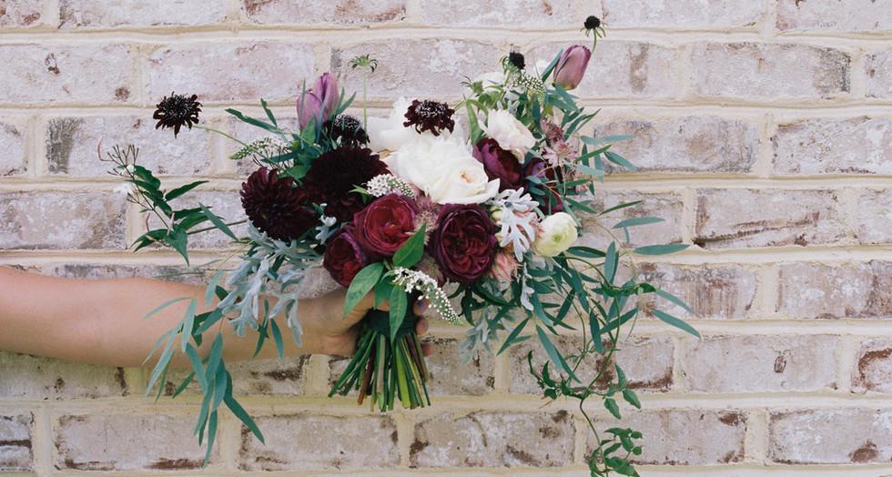 Flowers Against Brick Wall