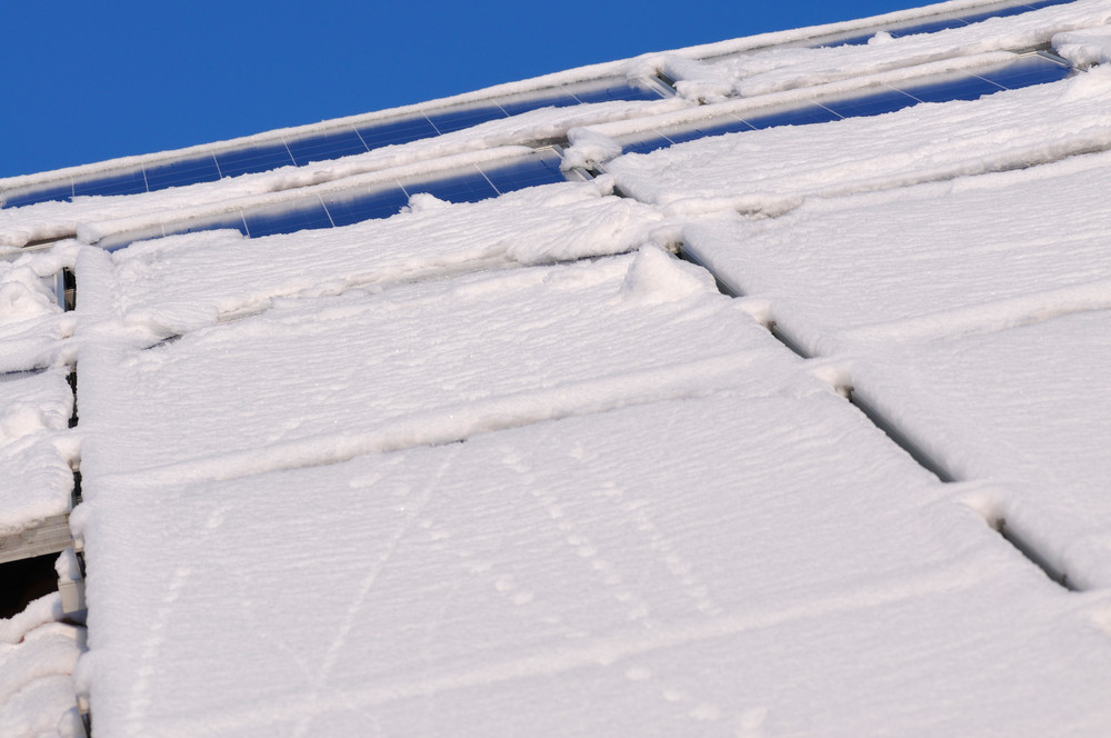 solar panels with snow covering them