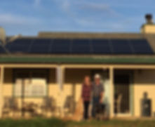 San Joaquin county home with SunPower solar panels on the roof and homeowners standing outside