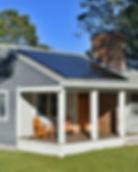 Grey house with Sunpower solar panels