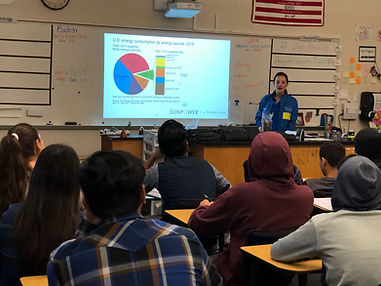 Chelsey Heil speaking to a science class about solar enegy