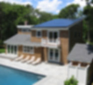 Brown wood shingled hous with pool and SunPower solar panels
