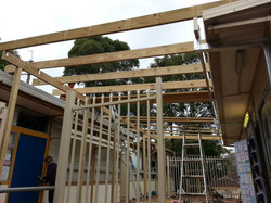 ERECT ROOF POST AND RAFTER