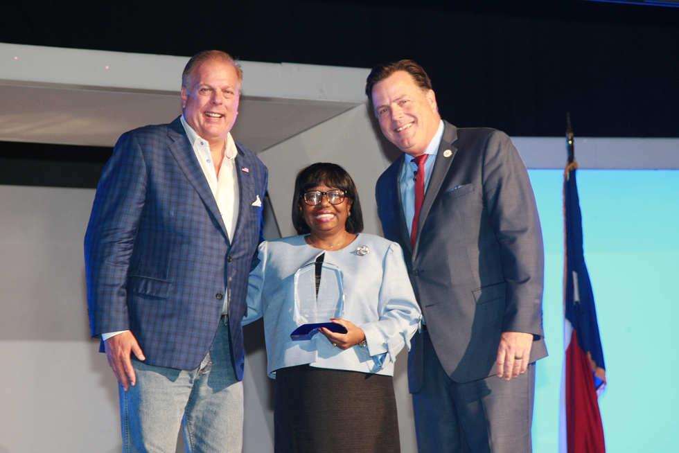 Recipient, Barbara Oldums; presenting the award are Arlington Mayor, Honorable Jim Ross an