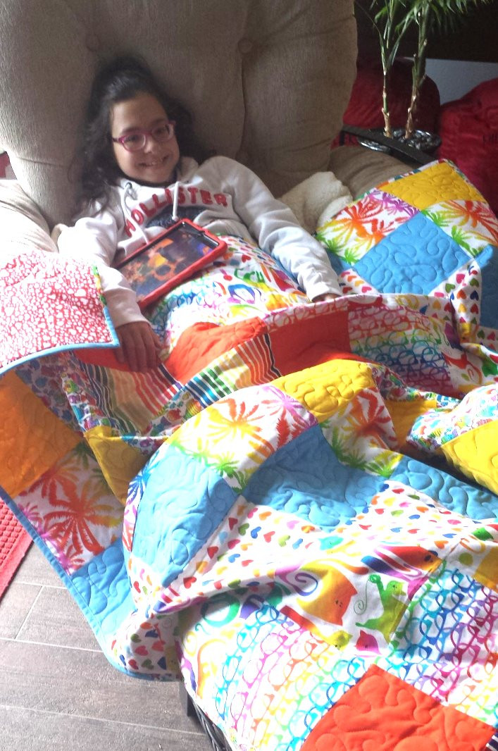 Keyan with her Love Sews quilt.