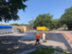 workers sealcoating parking lot