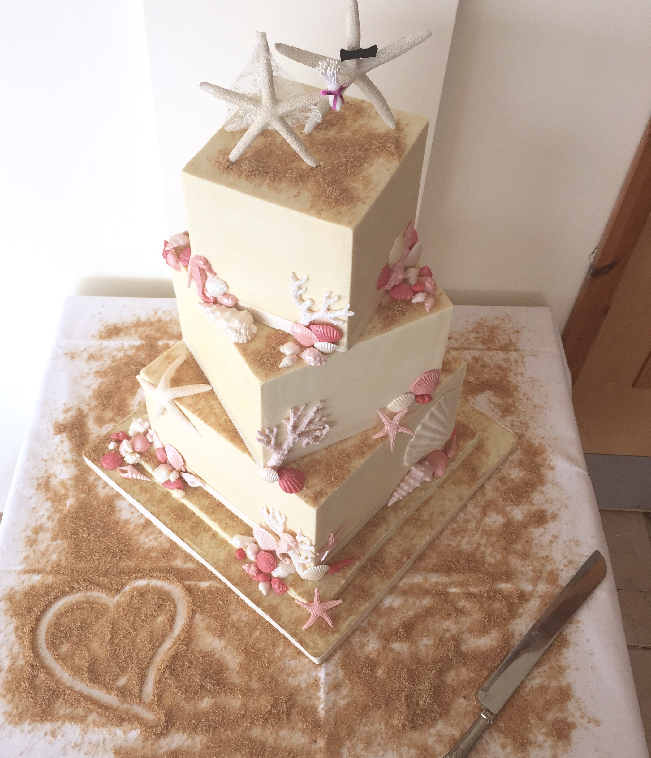 white chocolate three tier beach themed wedding cake