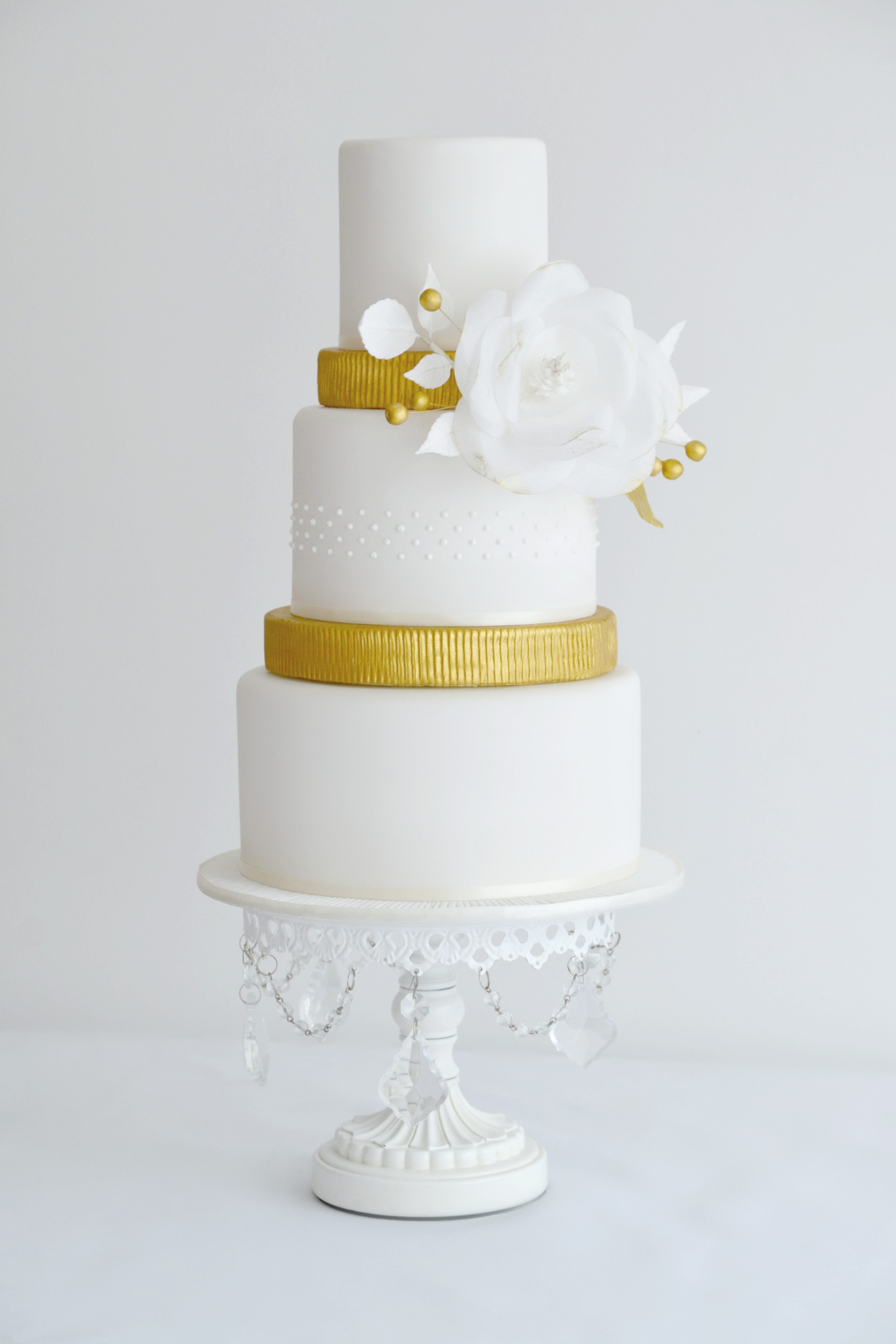 3 Tier white and gold wedding cake