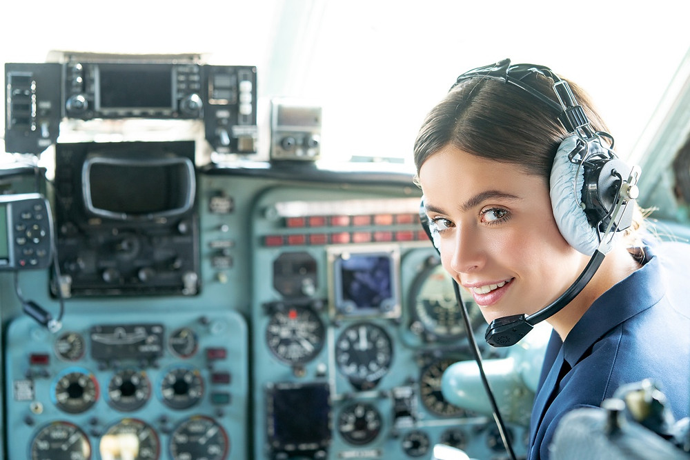 Smiling female pilot in the aircraft