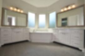 custom kitchen subway tile upgraded granite island with turned legs chicken wire pendants wood tile floors