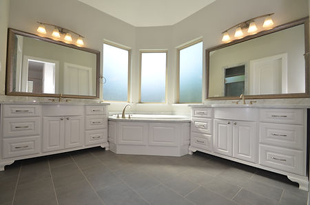 custom kitchen subway tile upgraded granite island with turned legs chicken wire pendants wood tile floors