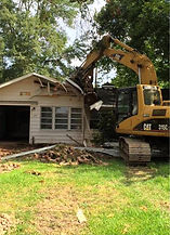 bulldozer tears down house in Houston to clear lot for Lipka custom home