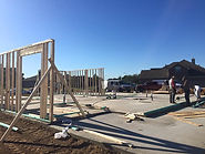 new home in Greater Houston foundation and start of framing for