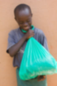 Ibrahim holding his bag of food