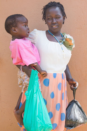 Benita and her mother collectig their bags of fod