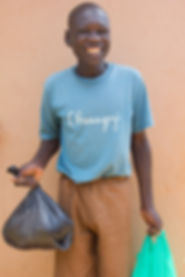 Halid smiling after recieving his bags of food