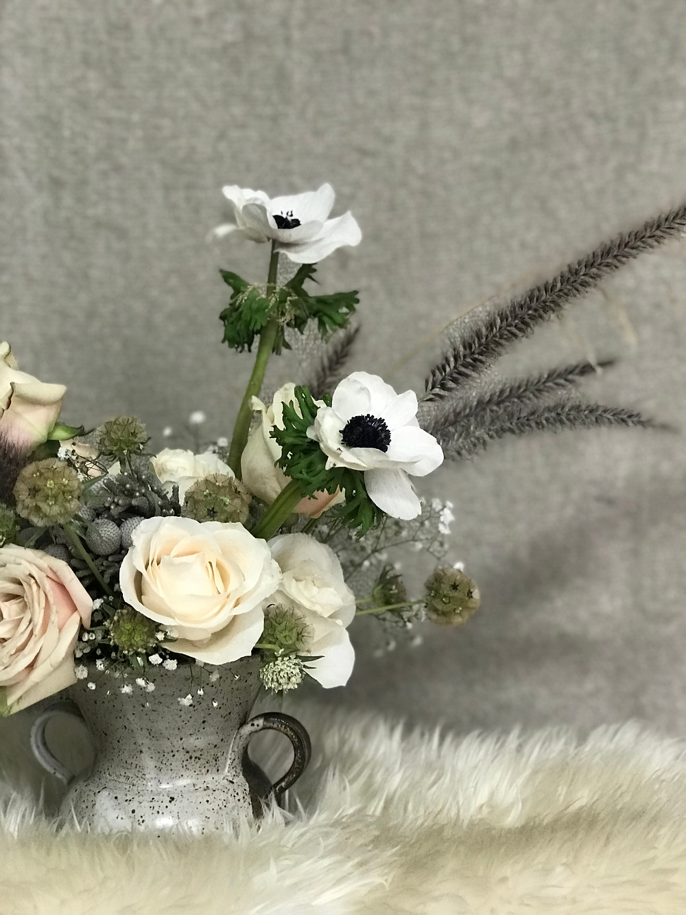 Close up of a floral arrangement for a winter wedding