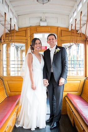 Bride and Groom pose on San Francisco cable car