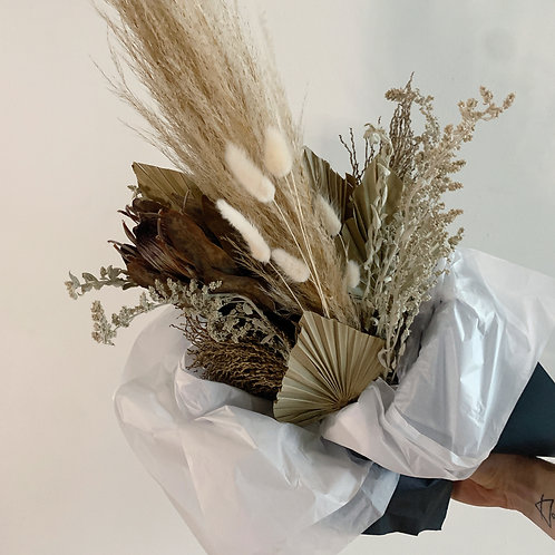 Dried floral bouquet with protea and sage