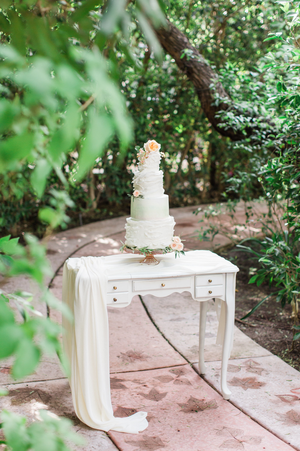 Textured white cake set upon a vintage desk