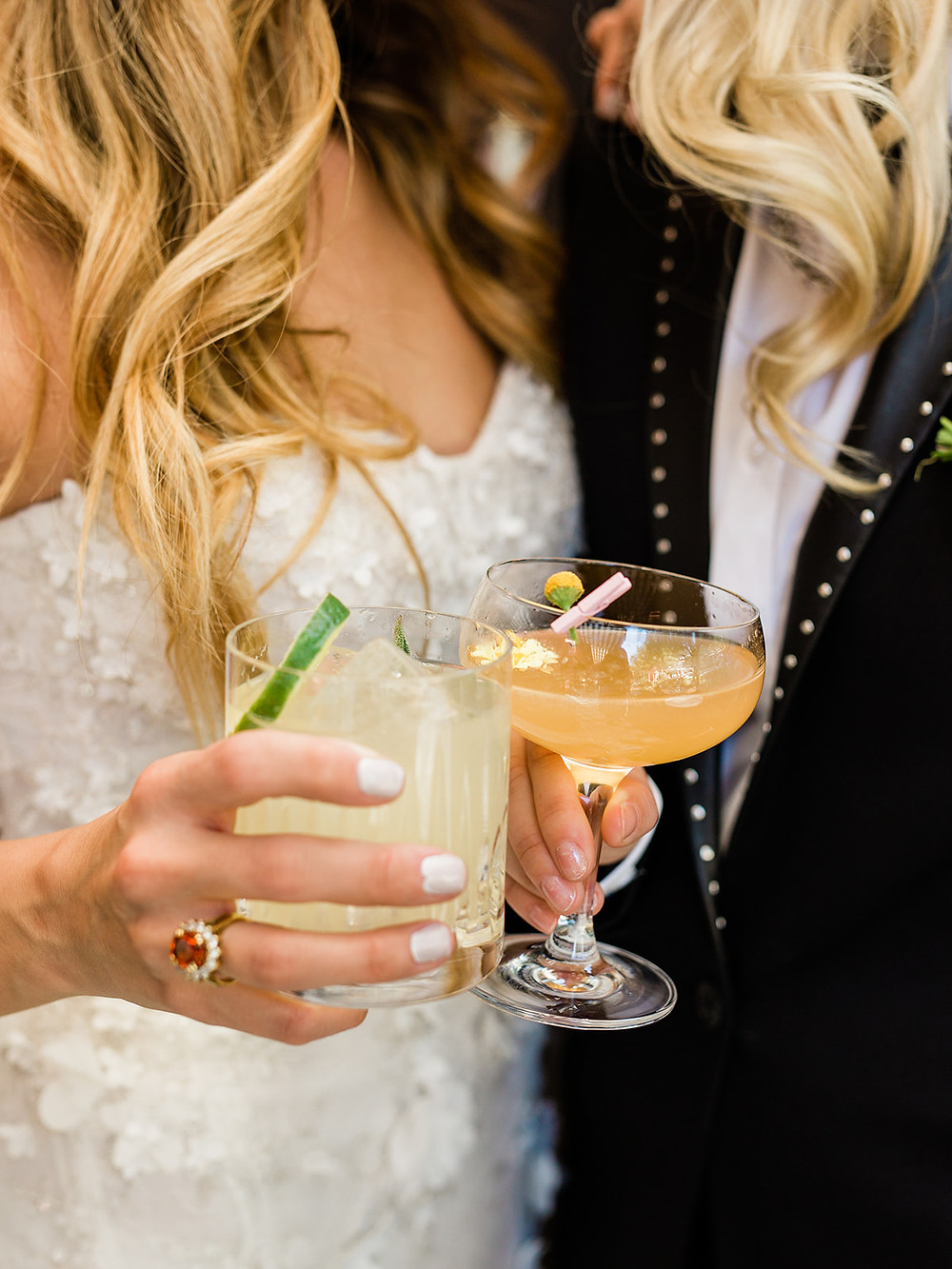 Two brides clink glasses after getting married - Modern Moroccan Desert Glam Editorial - LGBTQ Wedding Editoiral - Wedding Design Inspiration - Muted Desert Tones - Modern Glam Jungle Chic