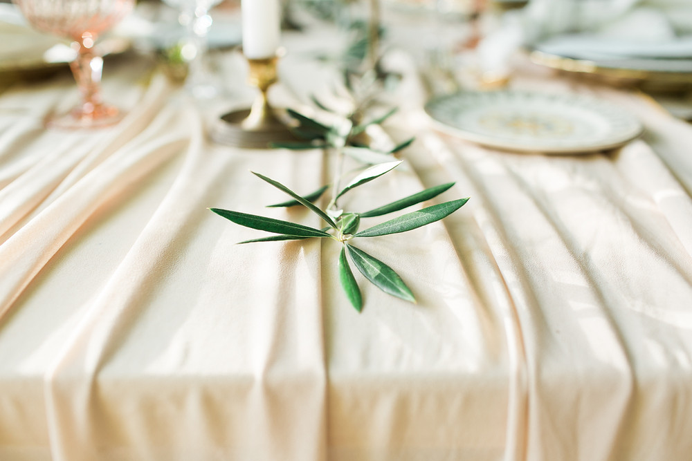 Table scape details featuring simple greenery