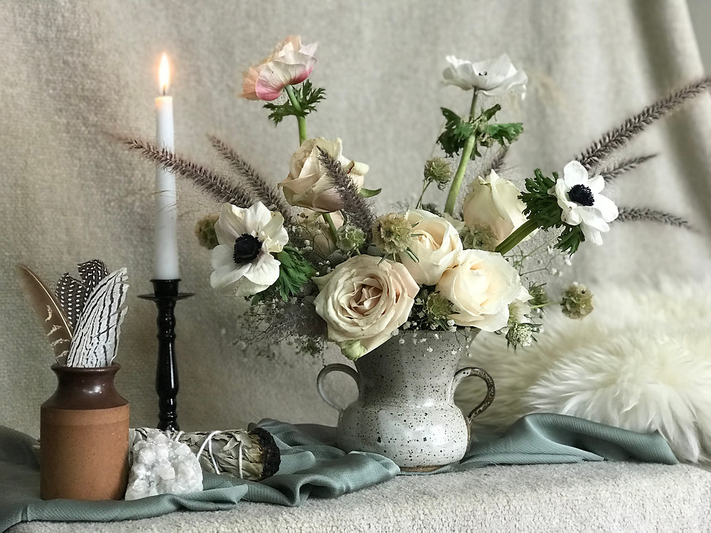 Floral arrangement and styling props for a winter wedding