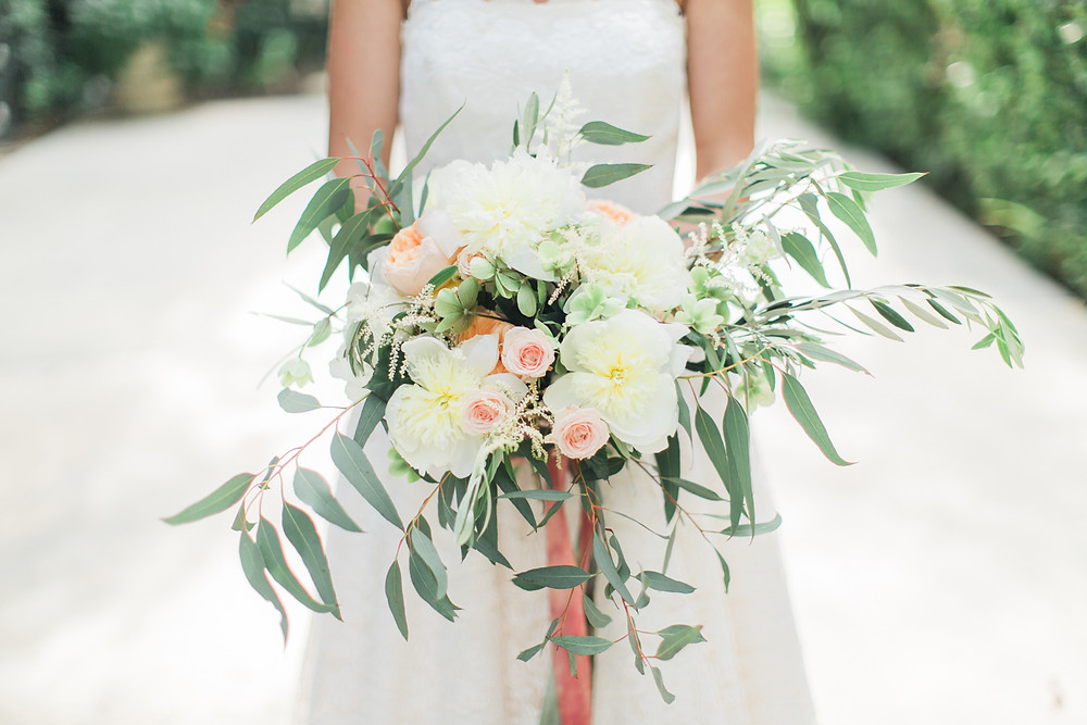 Bride showcases the stunning floral bouquet