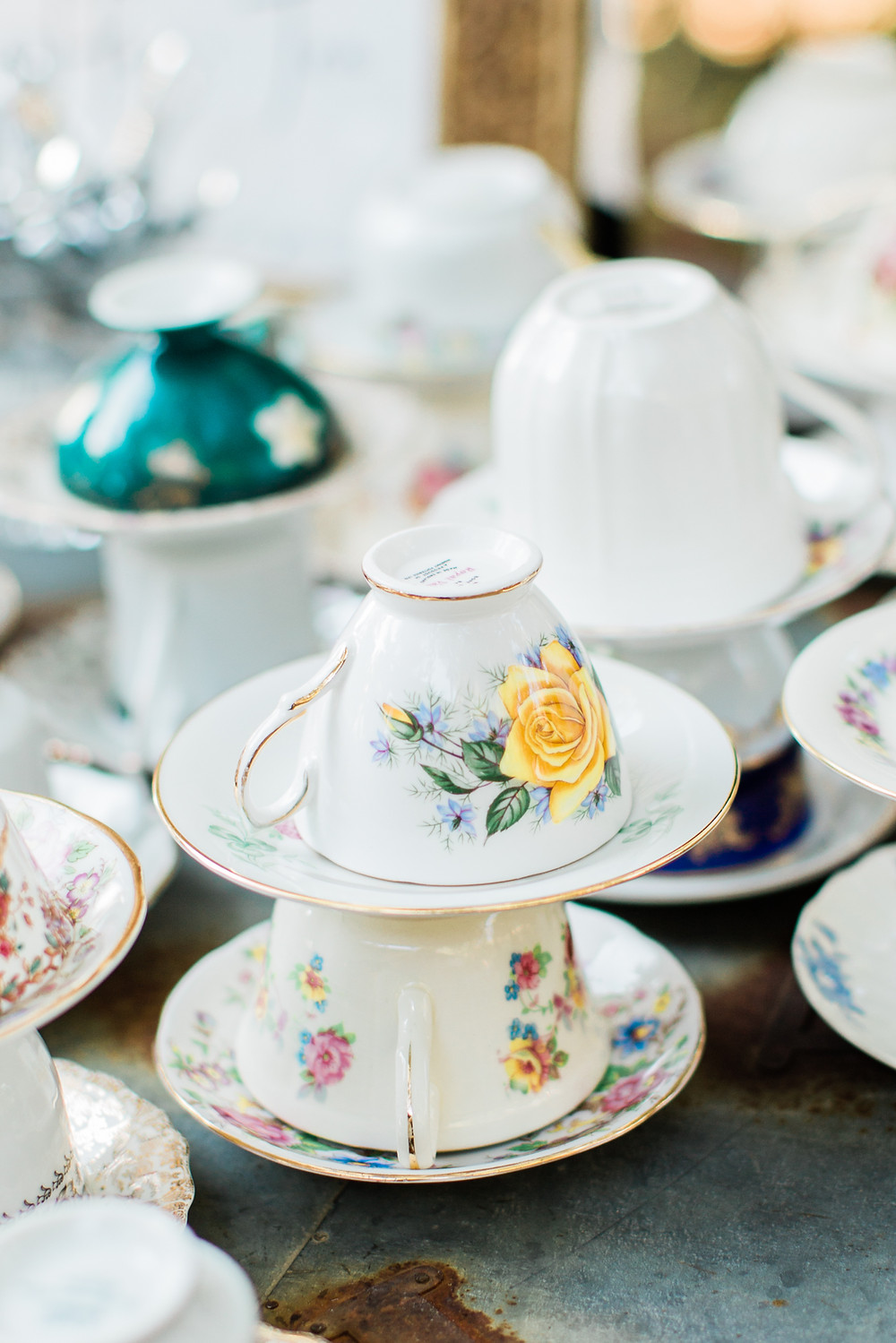 Mis-matched tea cups and saucers for dessert.