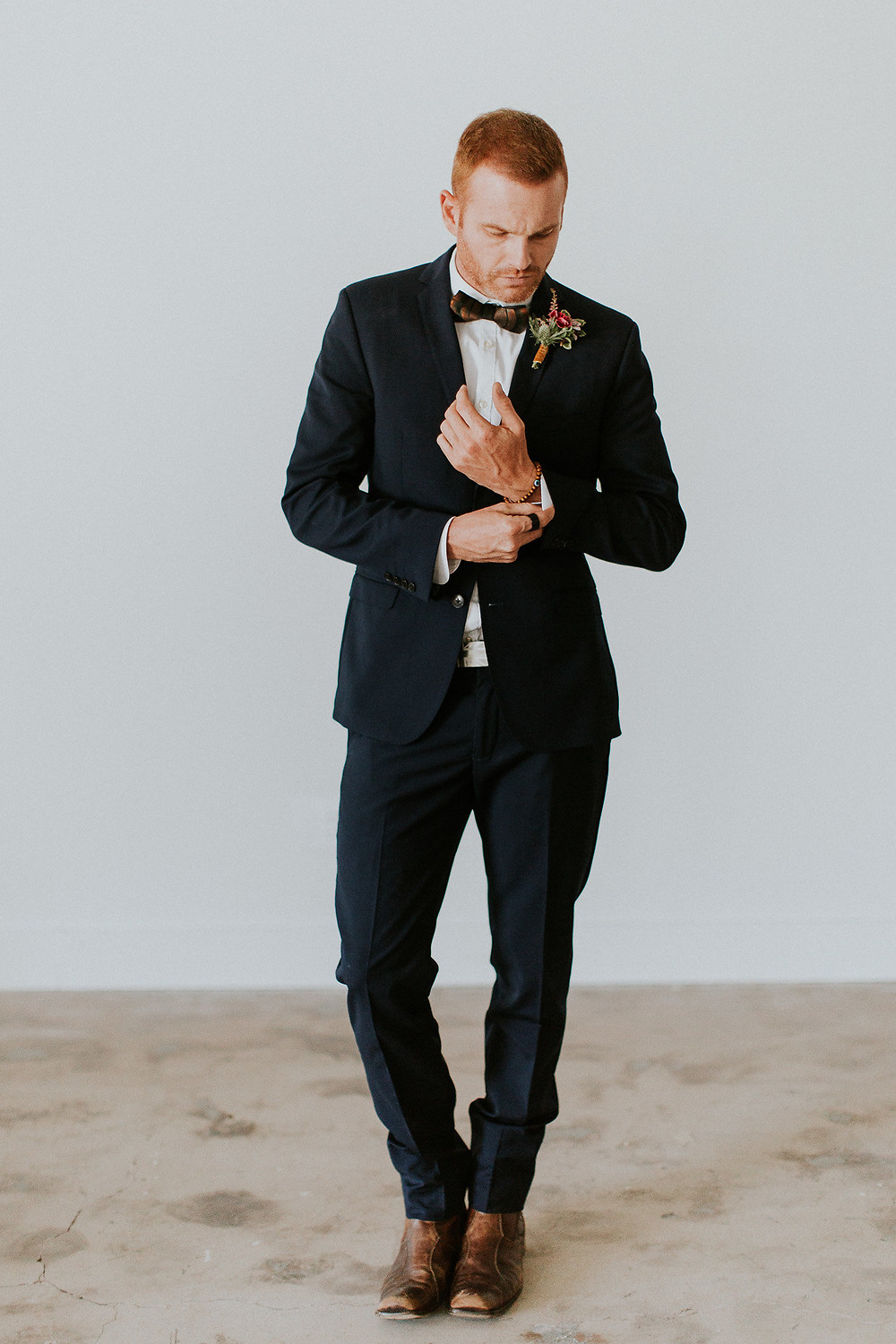 Groom finesses his look as he gets ready for the ceremony