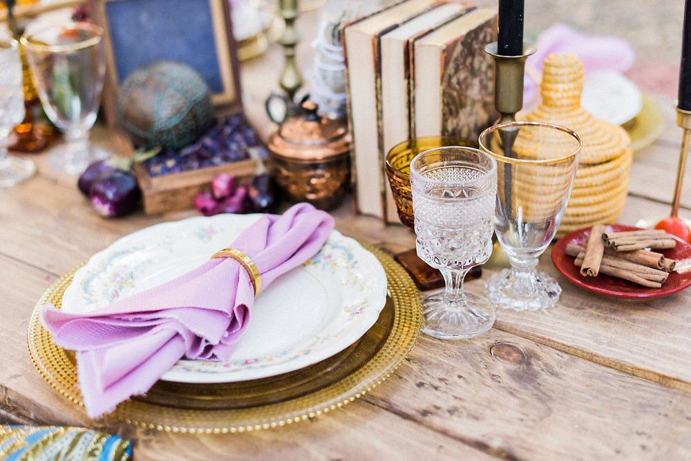 Dinner table set with organic ingredients and trinkets as a table runner