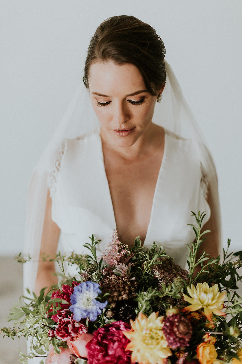 Bride poses with bridal bouquet