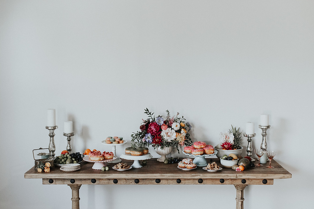 Dessert table featuring donuts and macaroons!