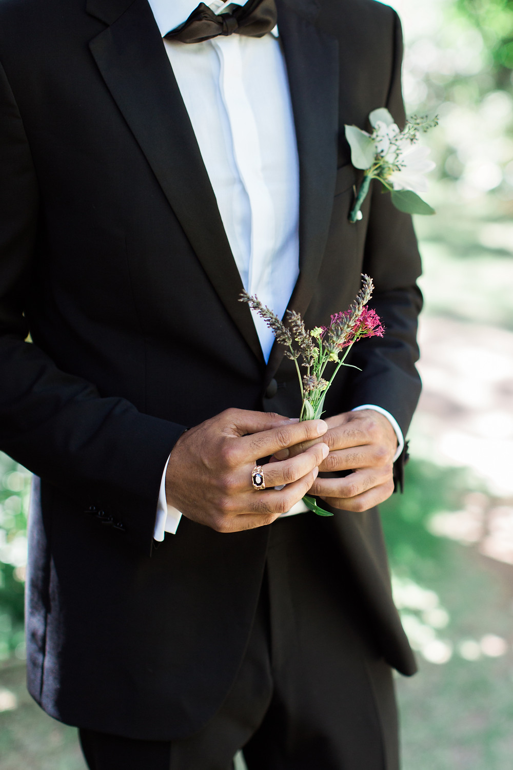 Groom hand-picked a small bouquet of flowers to give to his Bride during first look.