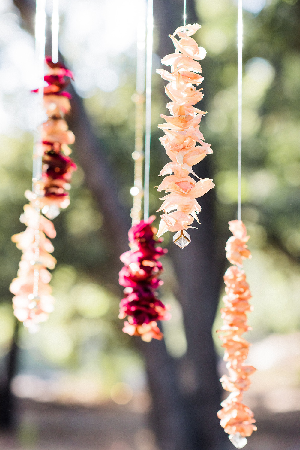 Dried flowers hang decoratively over the dining table
