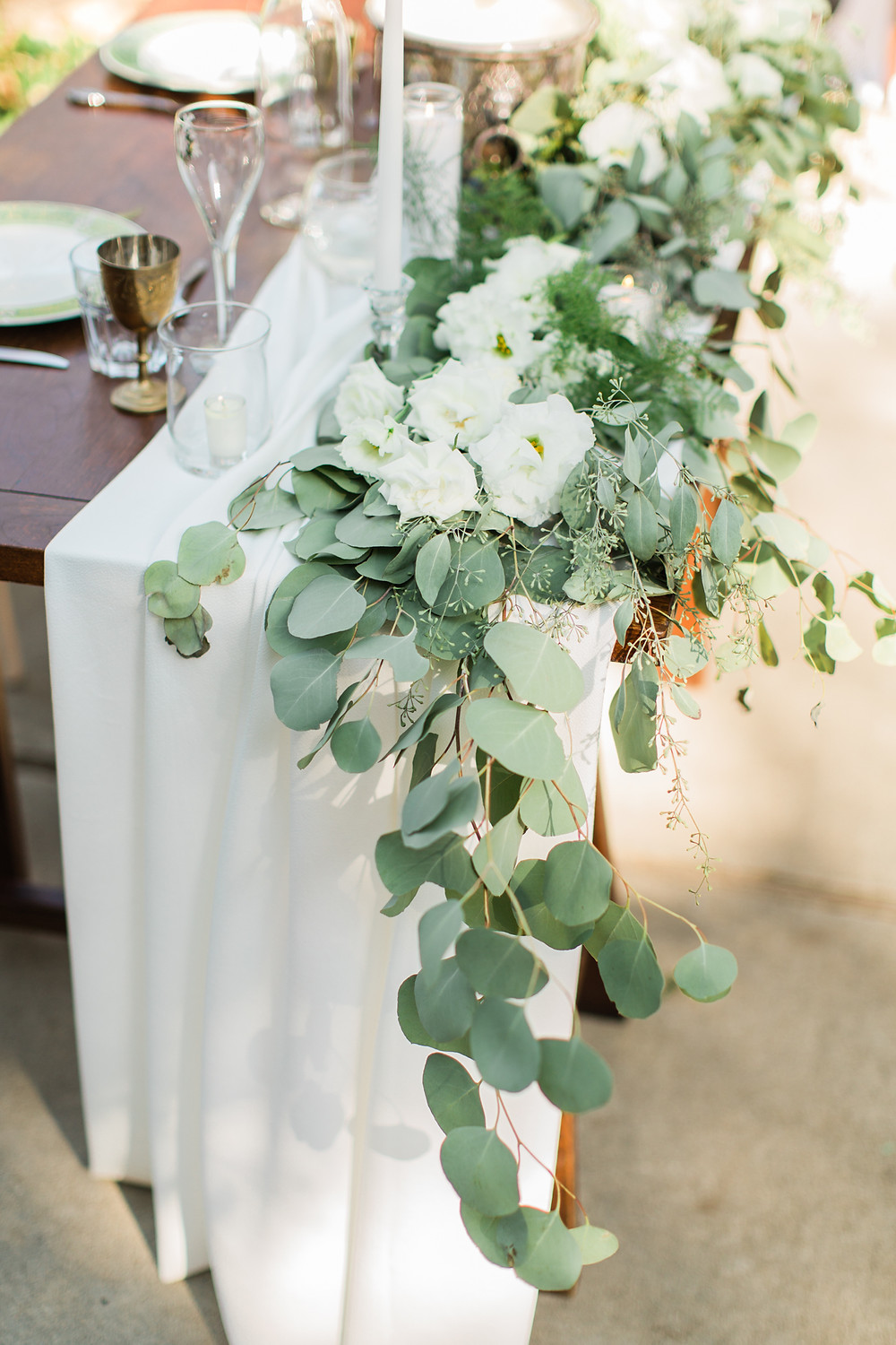 Floral details draped across the sweetheart table.