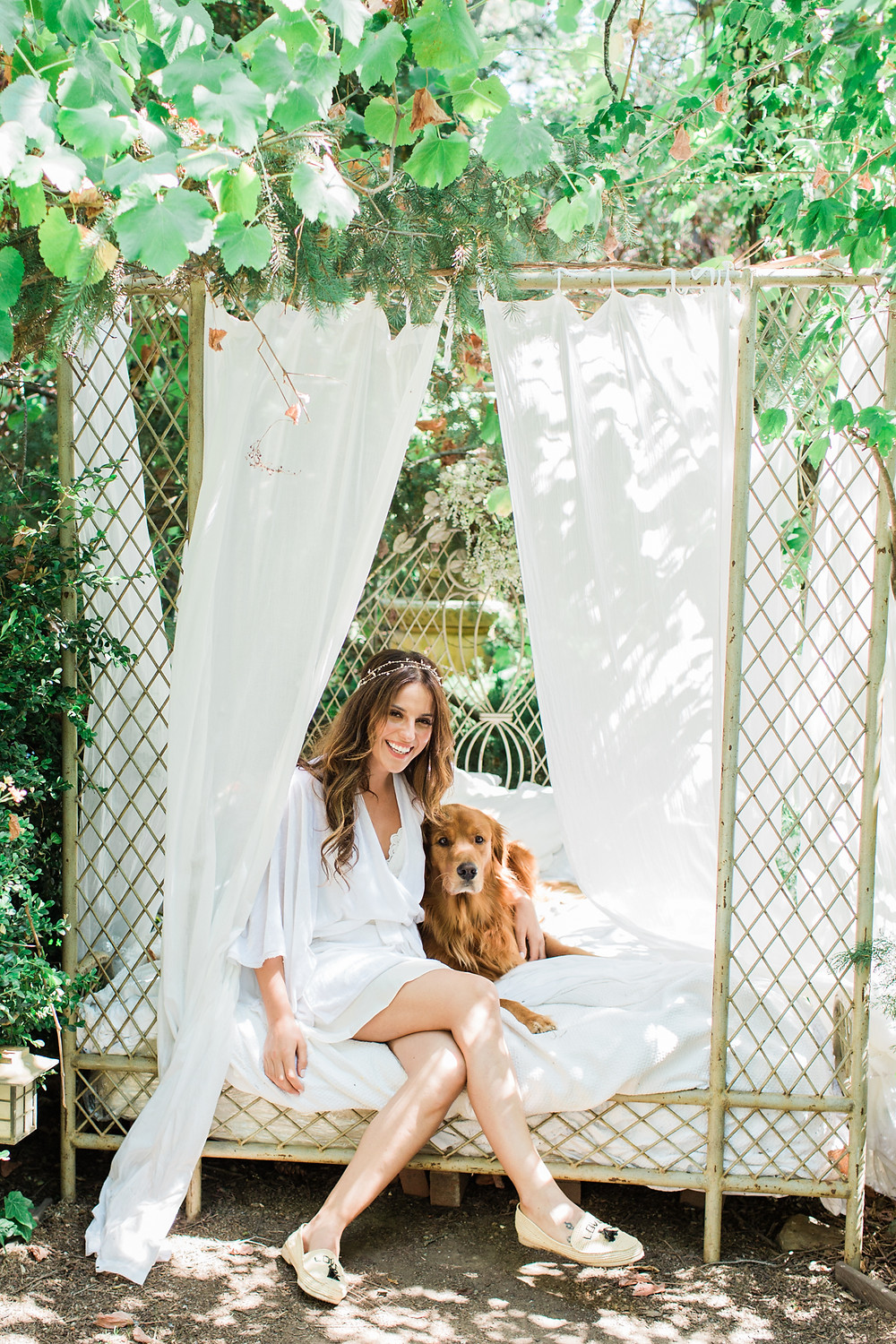 Bride poses with her dog Jake.