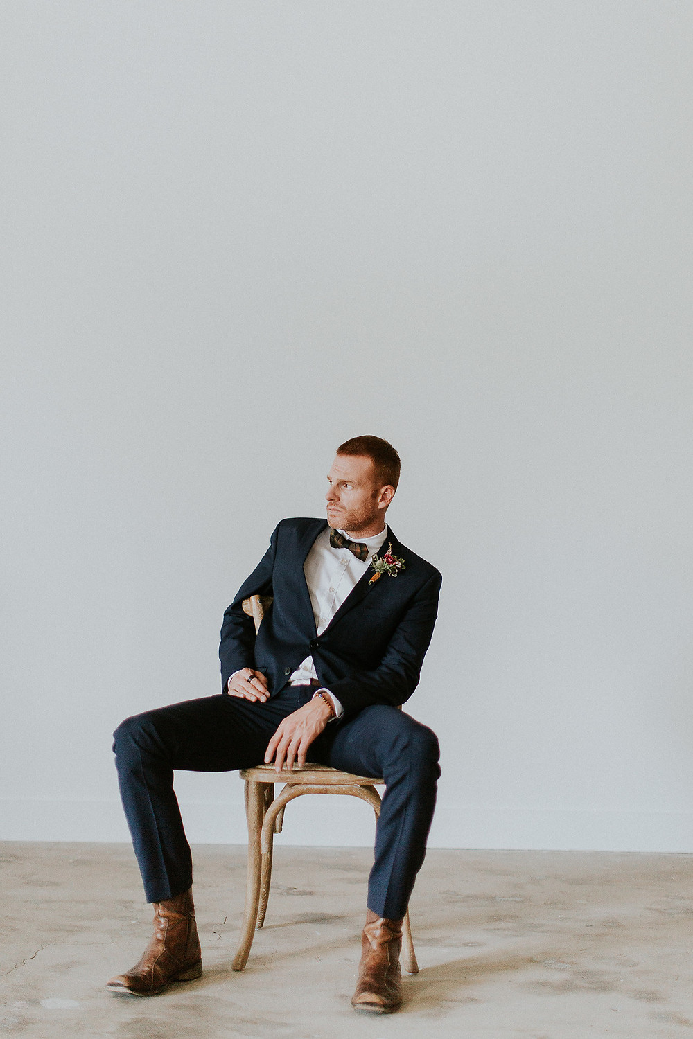 Groom sits and waits patiently for his bride