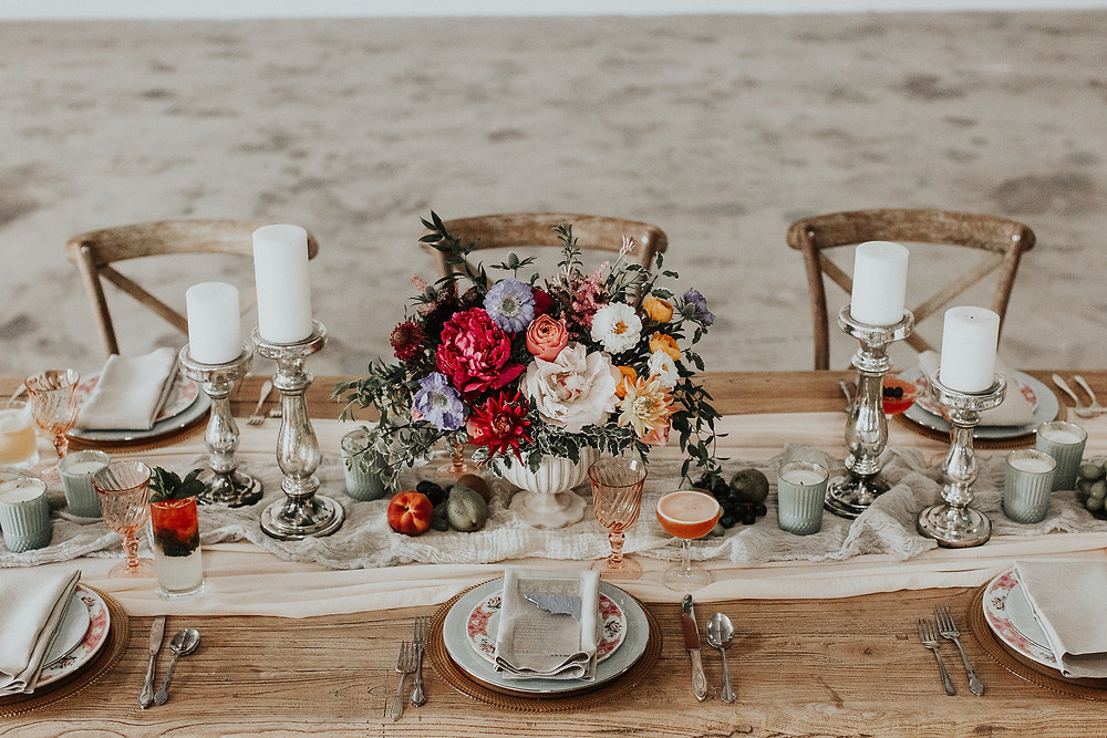 Dining table featuring hand dyed table runner, punchy florals, organic produce, and custom cocktails.