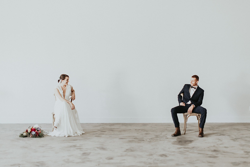 Bride and Groom look longingly at one another from across the room