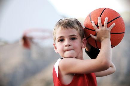 A child playing basketball