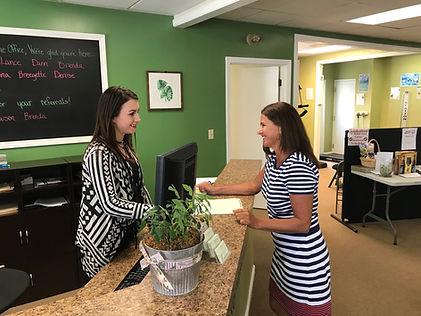 Chiropractic assistant welcomes new patient to In8Life Tressler Chiropractic office.
