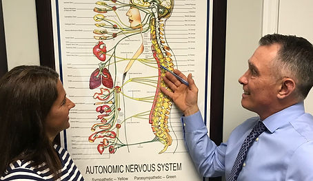 Dr. Tressler teaching the Autonomic Nervous System to a new chiropractic patient at In8Life.