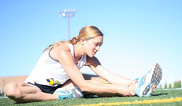 Woman stretching to prevent sports injury